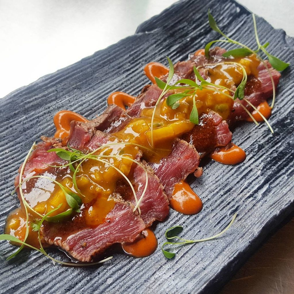 Warm beef fillet tataki with smoked aji panca pear andhellip