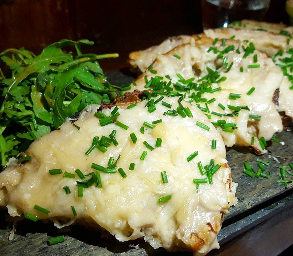 Mushroom bruschetta with a shedload of parmesan melted on top