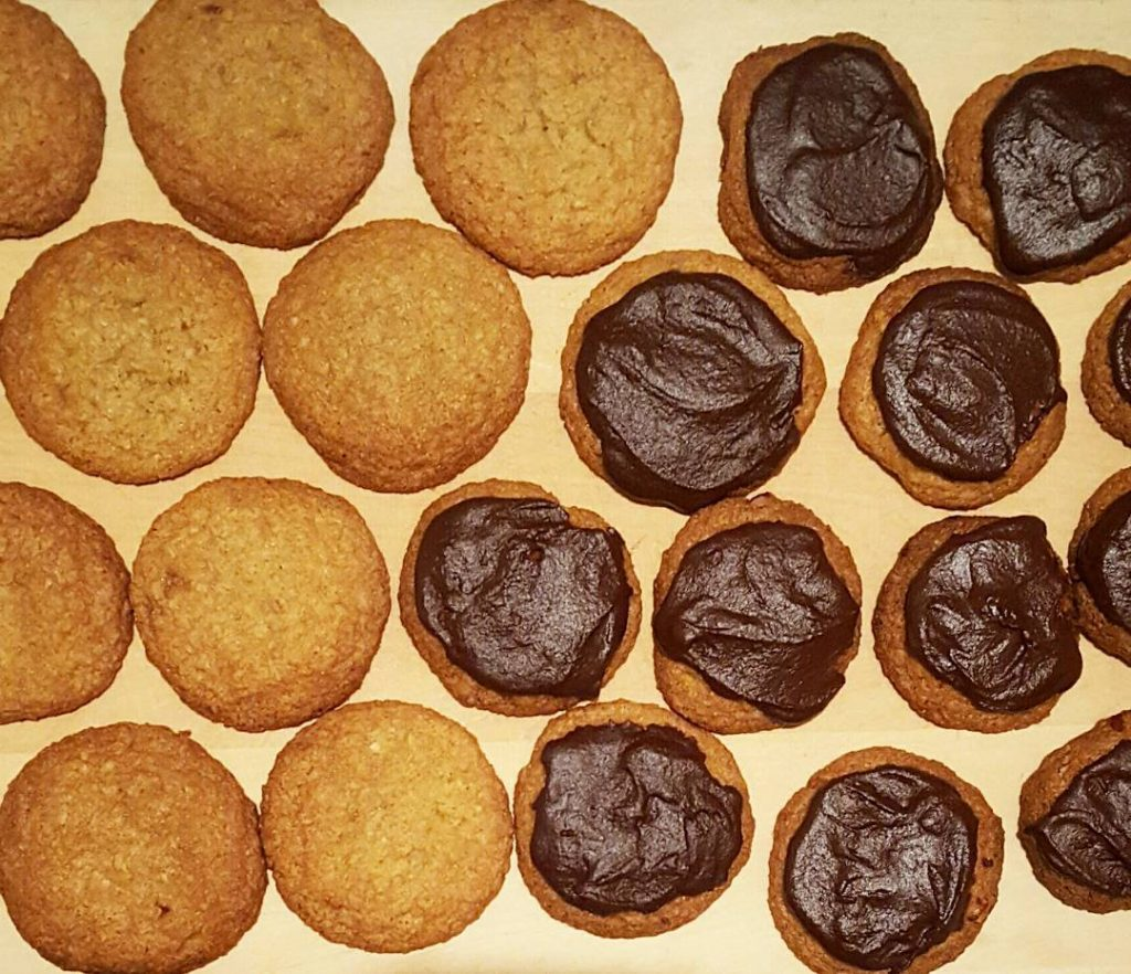 Coconut cookies half slathered in chocolate