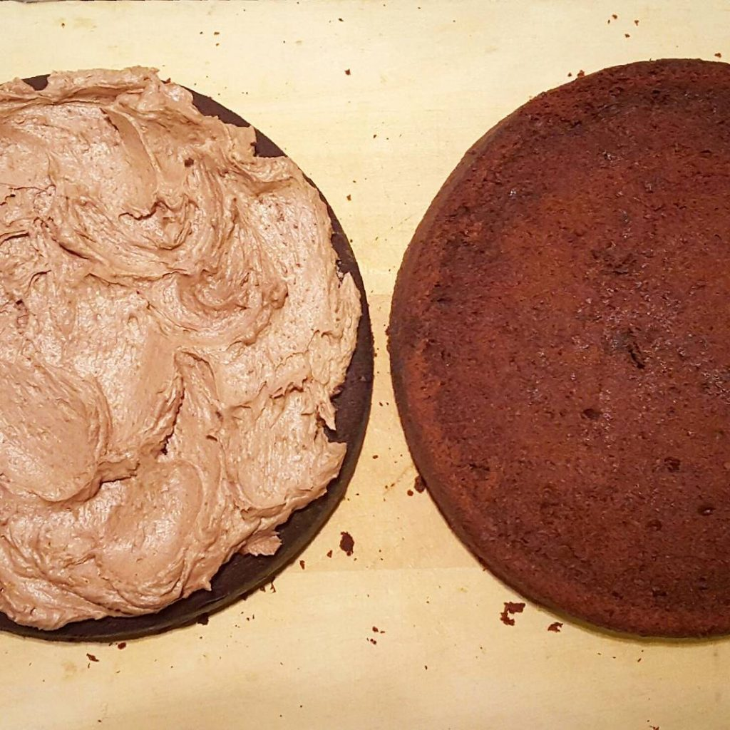 Sponge sliced in half and sandwiched together with chocolate buttercream
