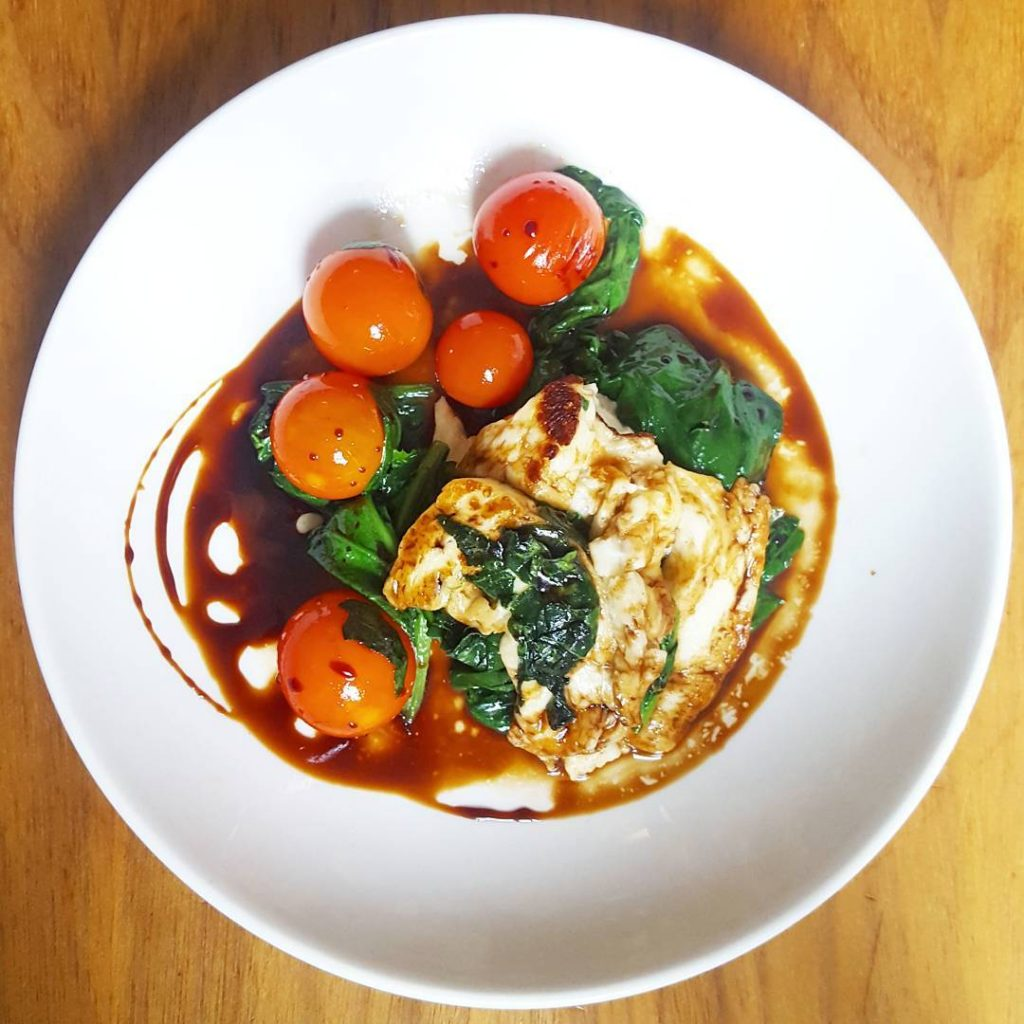 Panfried halloumi spinach and cherry tomato with balsamic glaze