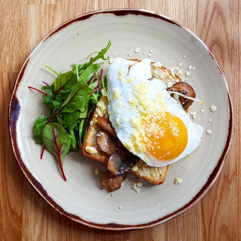 Fried duck egg wild mushrooms and Bomber cheese on toastedhellip