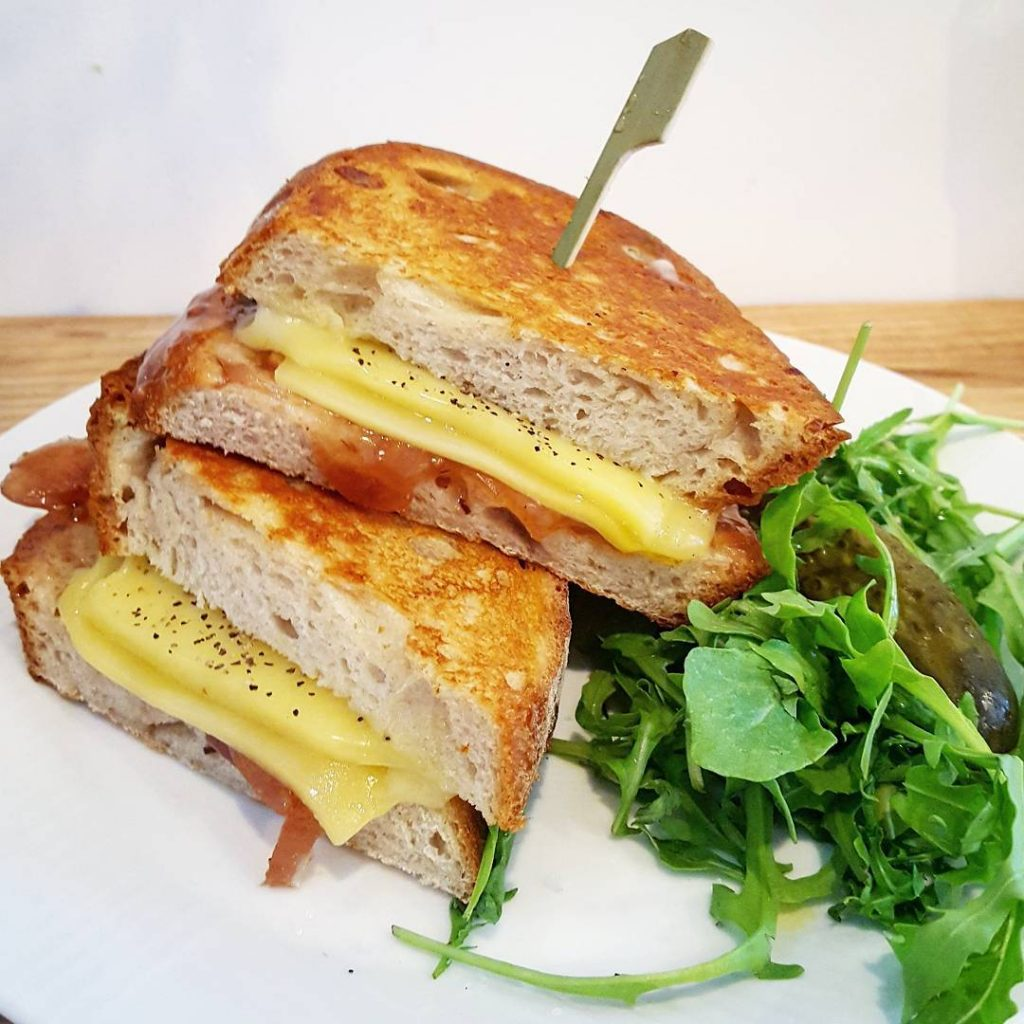 A toasted comte and red onion chutney sandwich at kafcoffeehellip