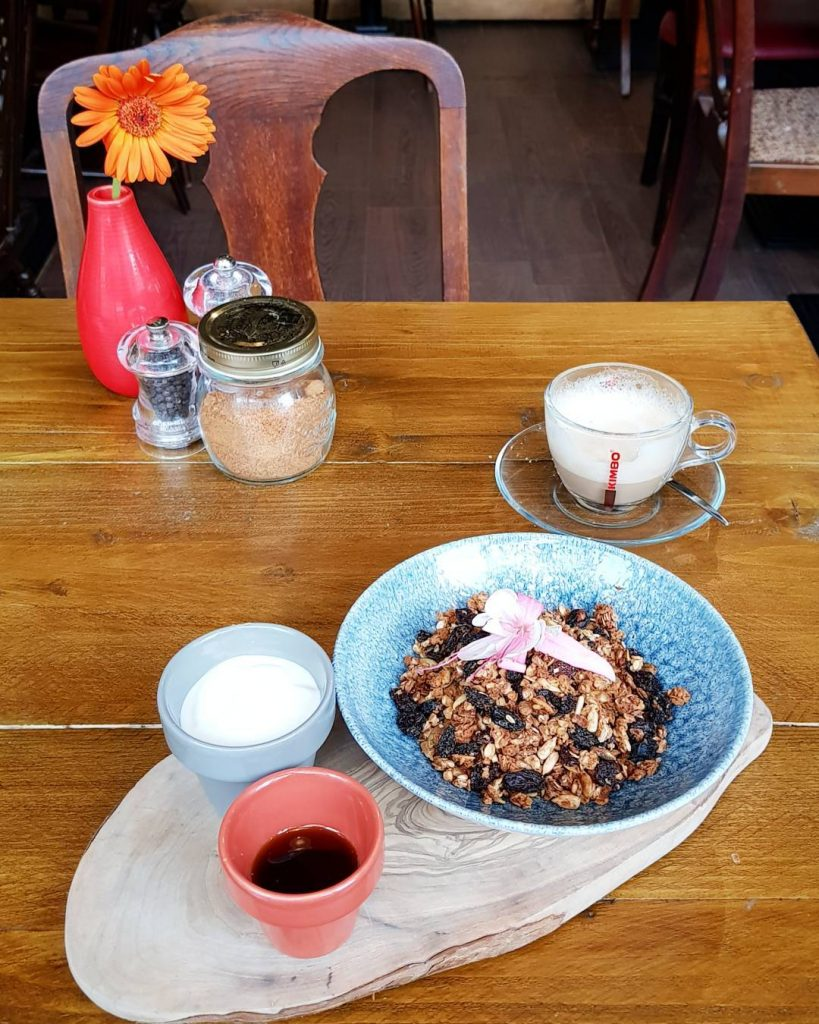 Homemade granola natural yoghurt and organic maple syrup at downtoearthoghellip