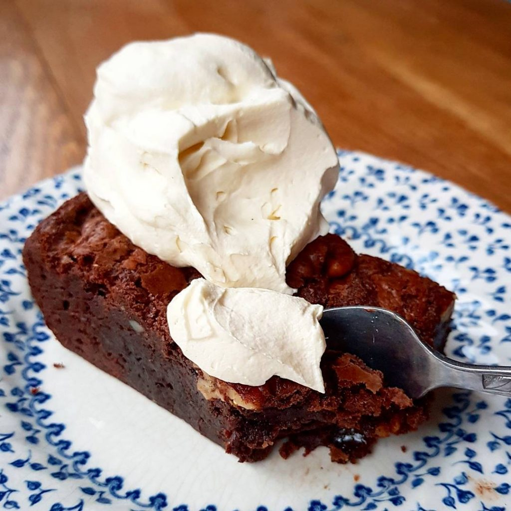 This warm cafestrangebrew pecan brownie with whipped cream is takinghellip