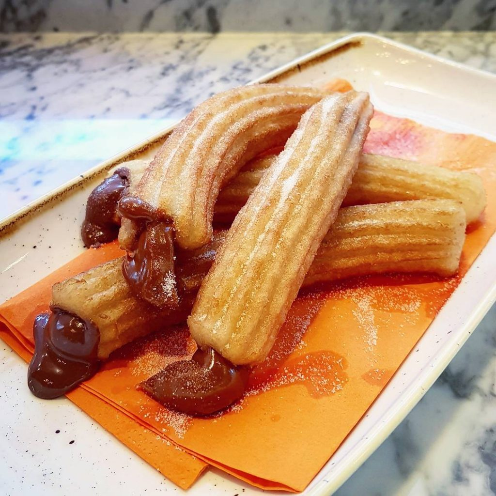 Churros at loopandscoopfilled with dulce de leche and nutella